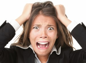 Woman pulling her hair out in stress